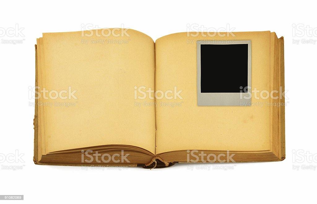 41b2089650 Vieux livre avec cadre photo vide à l'intérieur photo libre de droits