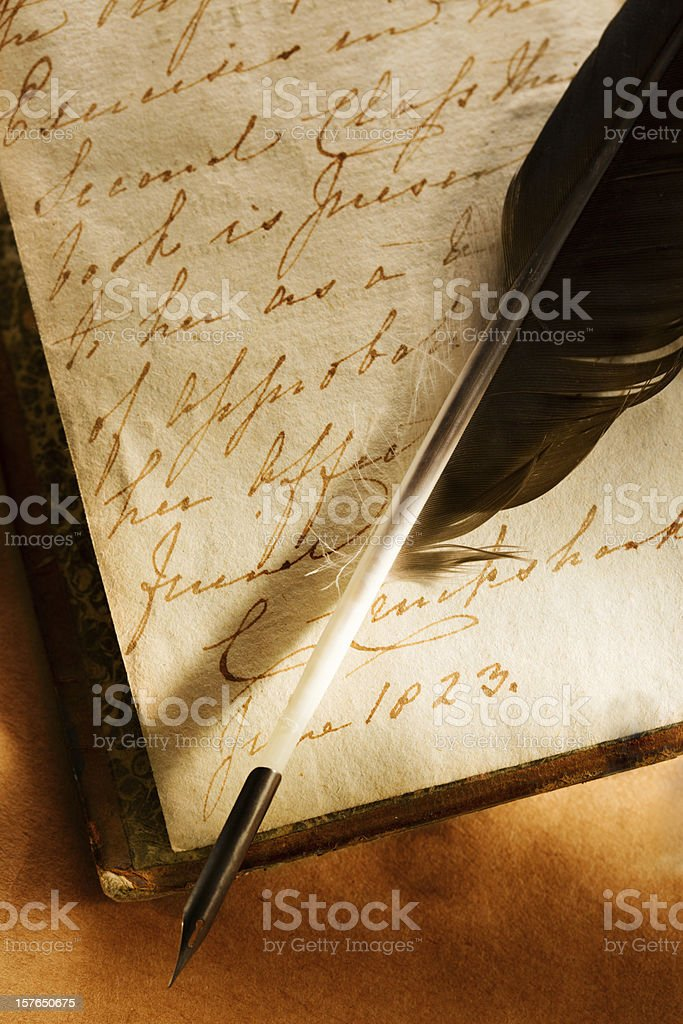 Old book with feather pen royalty-free stock photo