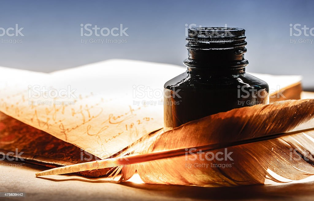Old book with feather pen stock photo