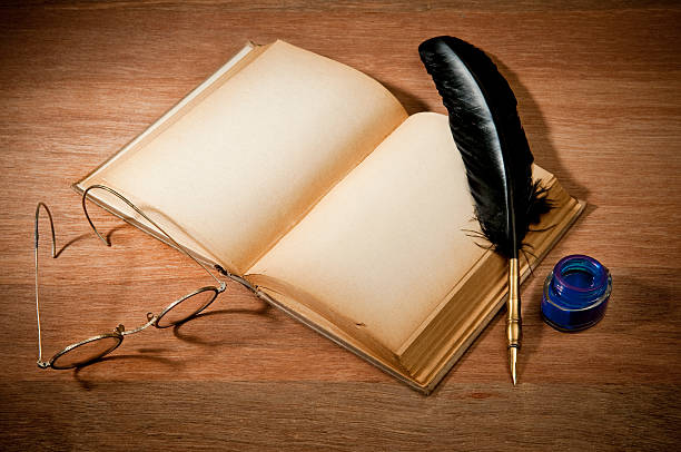 old book with quill pen - ink well stock photos and pictures