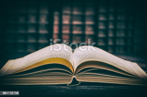 istock Old book wooden library desk concept. 984126708
