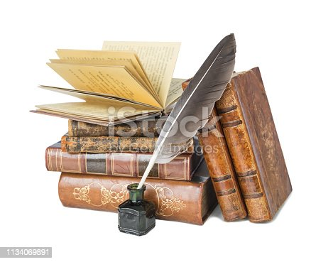 Pile of the old books and a quill in the inkwell isolated on a white background