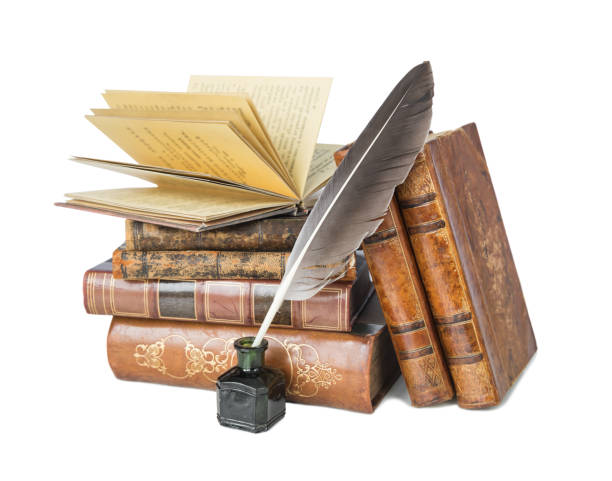 Old books and a quill stock photo