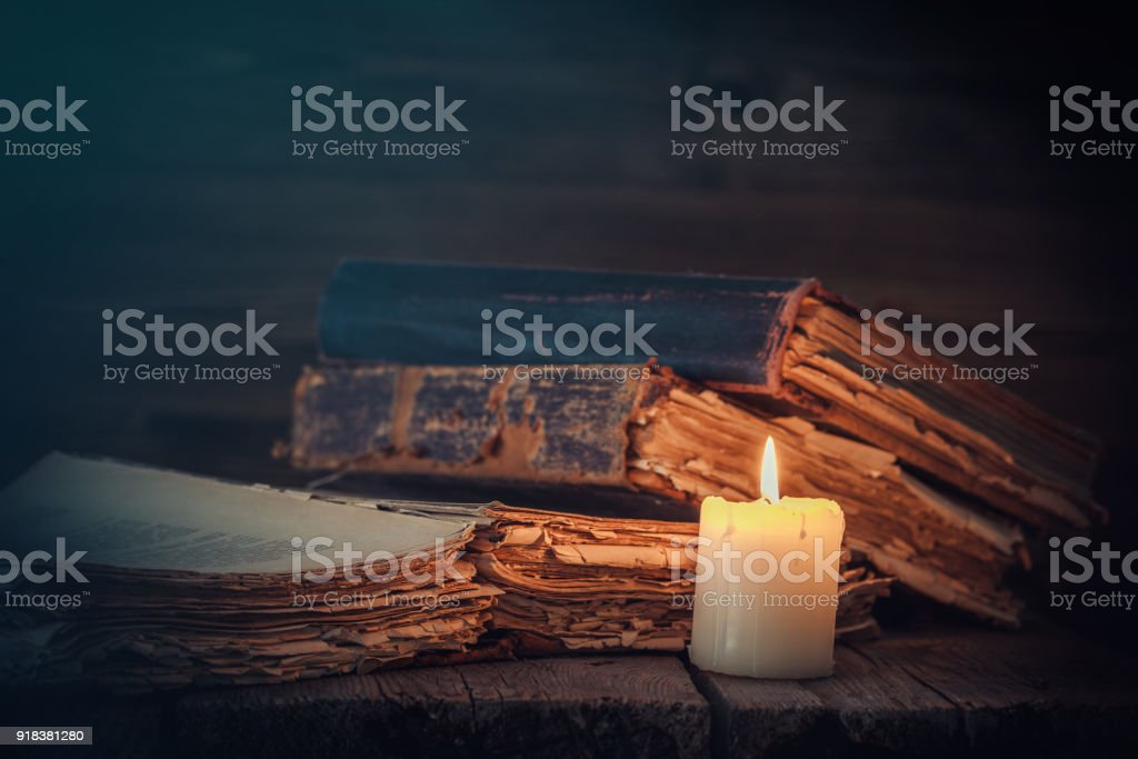 Old books and candle. stock photo