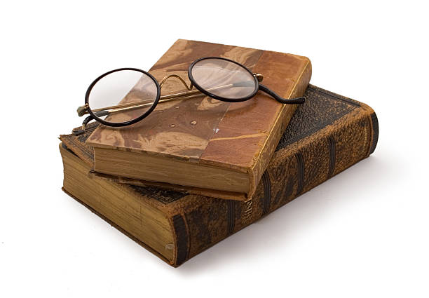 Old books and glasses stock photo