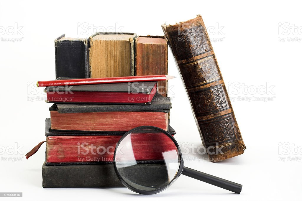 old books and magnifier royalty free stockfoto