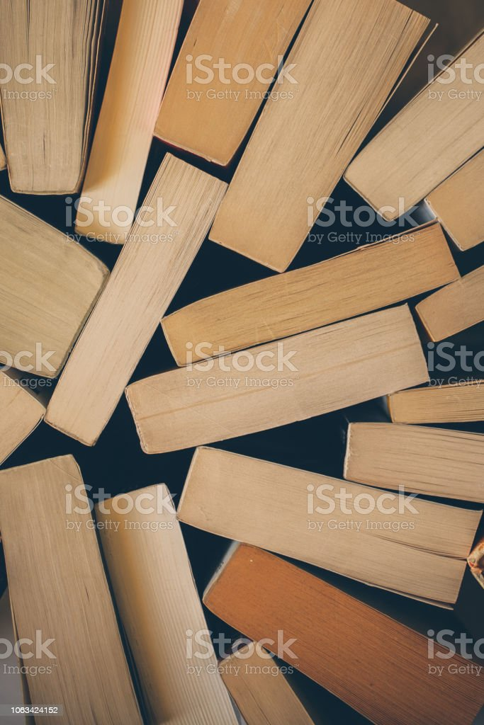 Old books background. Top view of old vintage books. Education and...