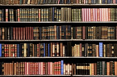 Desaturated colors. Old books in a library