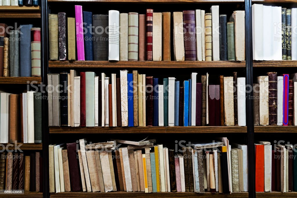 Old books in a library stock photo