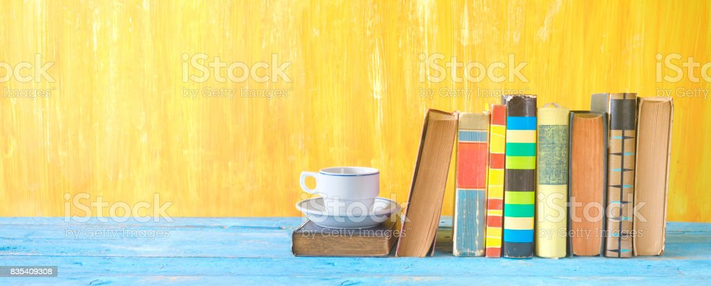 old books in a row stock photo