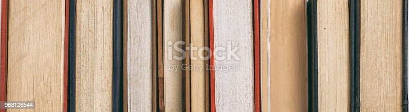 istock Old books in row 983126544