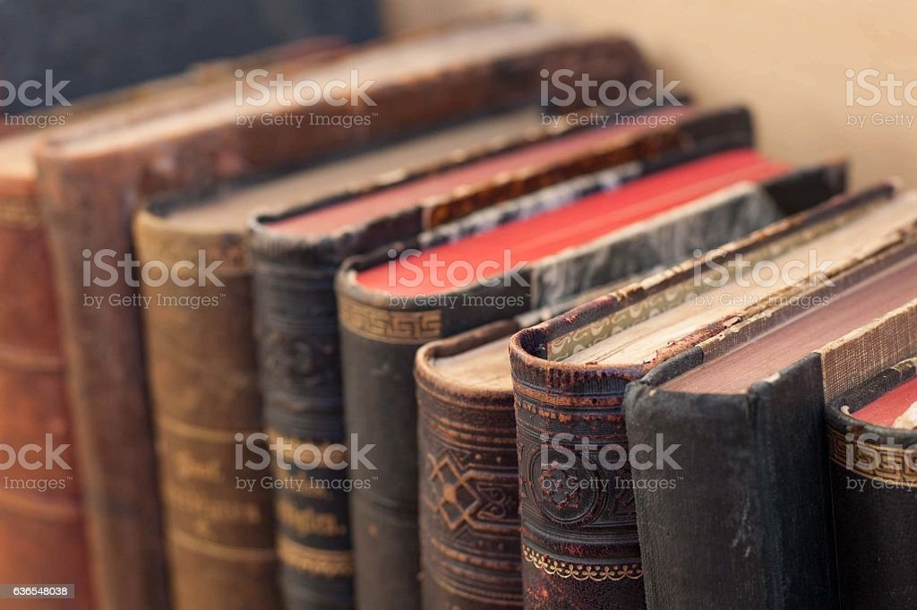 Old books on a shelf. stock photo