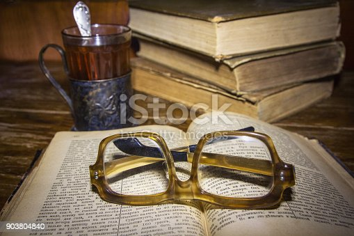 istock Old books on a woodentable. 903804840