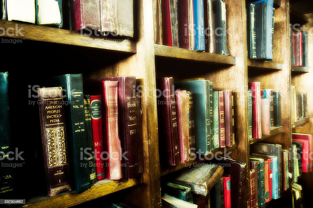 Old books on bookshelf stock photo
