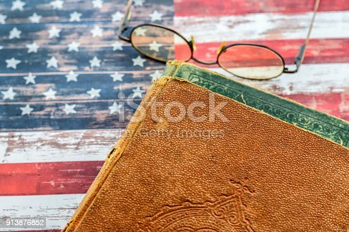 1034955096 istock photo Old books on USA flag 913876852