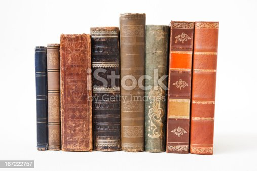 ld books on white background.  Damages from aging.