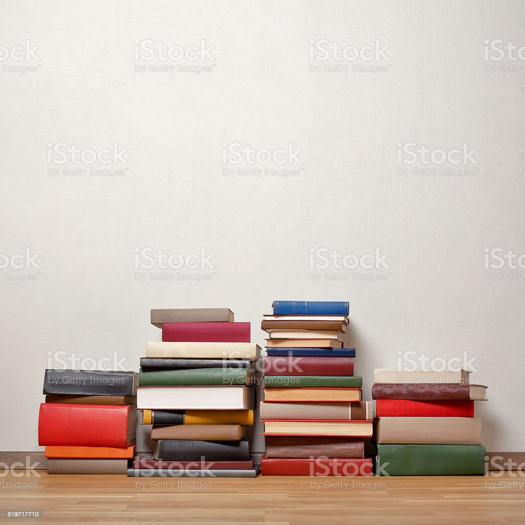 Old books on wooden floor stock photo