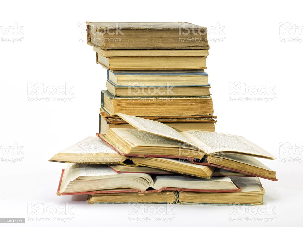 Old books pile vertical isolated stock photo