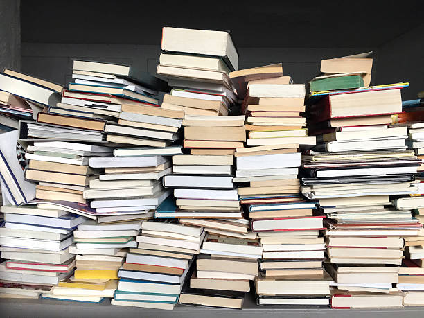 old books piled on table stock photo