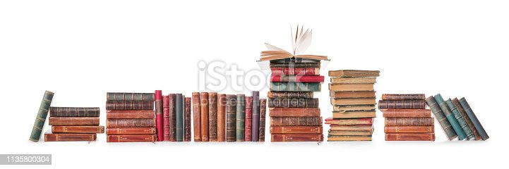 Long old books row isolated on white, clipping path included