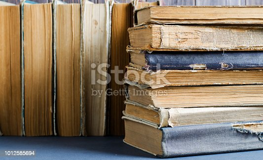 121305595 istock photo Old books with crumpled, torn covers. Close up 1012585694