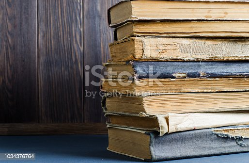 537881816 istock photo Old books with crumpled, torn covers. Copy space 1034376764