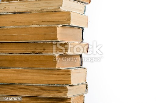 537881816 istock photo Old books with crumpled, torn covers. Isolated on white 1034376750