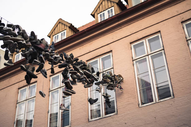 Old boots hanging on rope in Flensburg stock photo