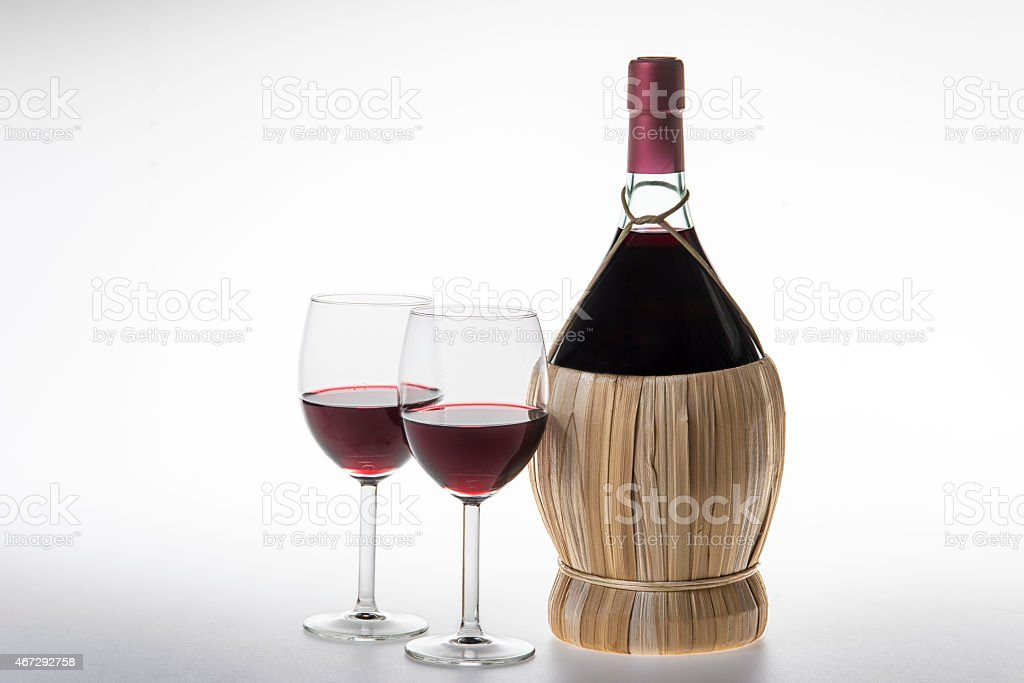 Old bottle and glasses of chianti wine stock photo