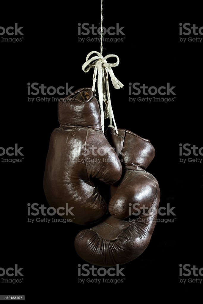 old Boxing Gloves, hanging, isolated on black Background stock photo