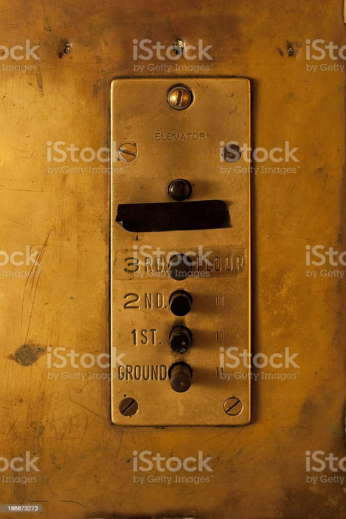 Old Brass Elevator Panel stock photo