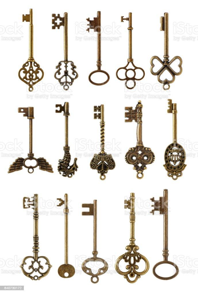 Old brass key isolated on white background stock photo