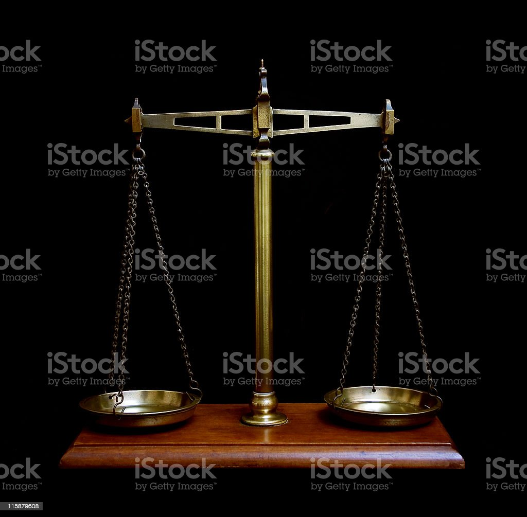 Old brass kitchen scales on black background royalty-free stock photo