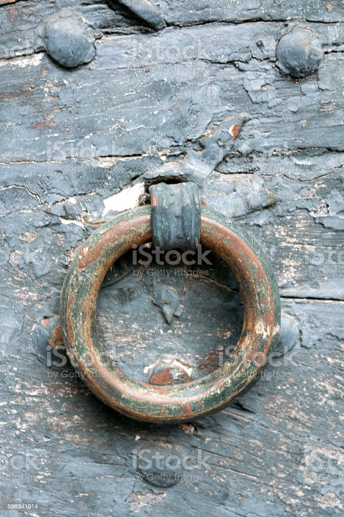 old brass knocker on a ancient door royalty-free stock photo