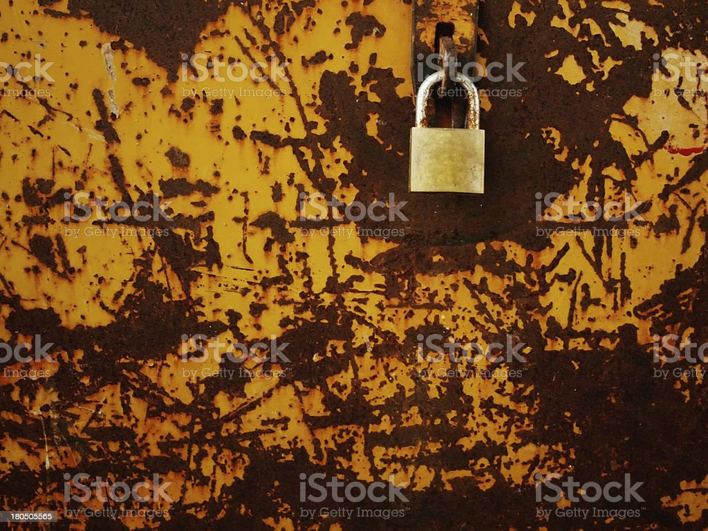 Old brass lock on rust steel plate royalty-free stock photo