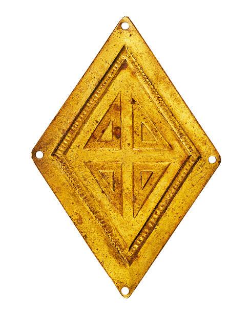 Old brass rhombus stock photo