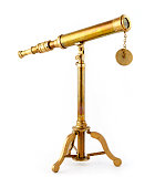 Old brass telescope on a pure white background.