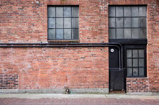 Old brick alleyway with windows