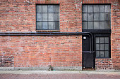Old brick alleyway with windows