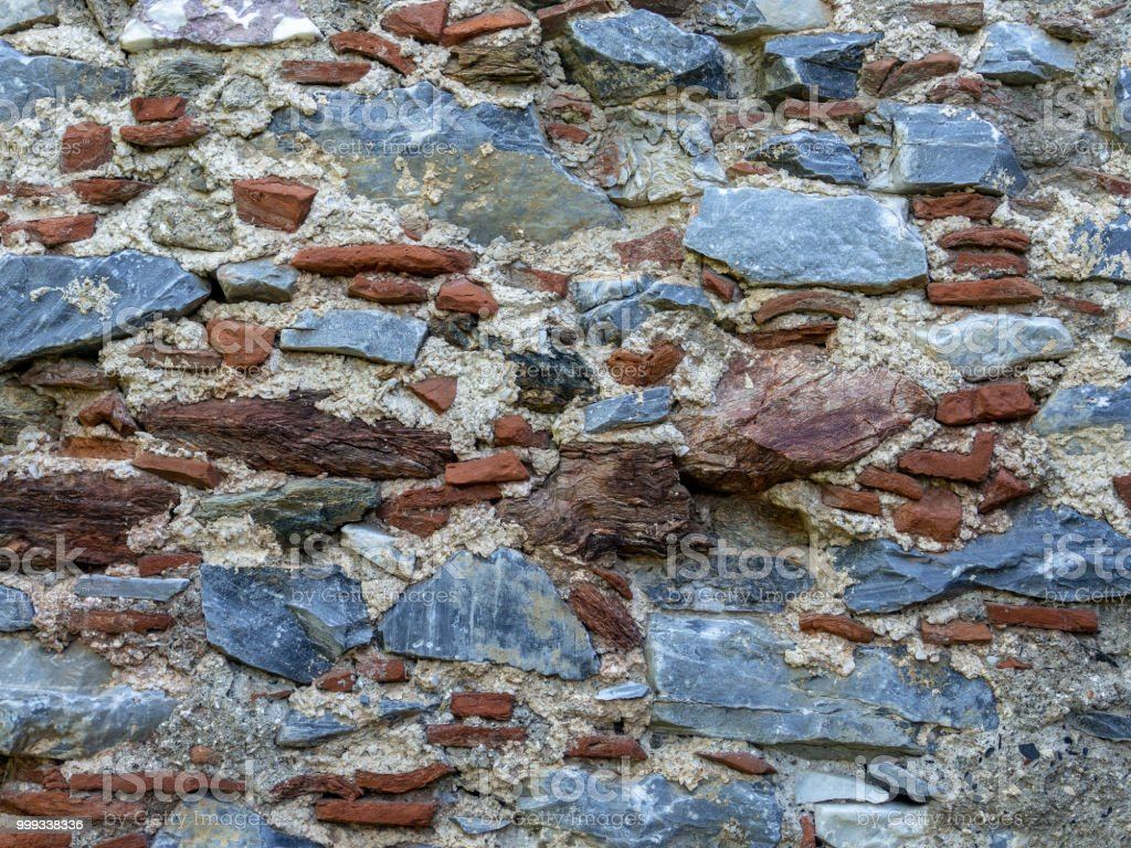 old brick and stone mixed wall - foto stock