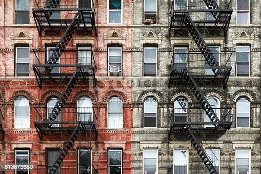 istock Old Brick Apartment Buildings in New York City 613673680