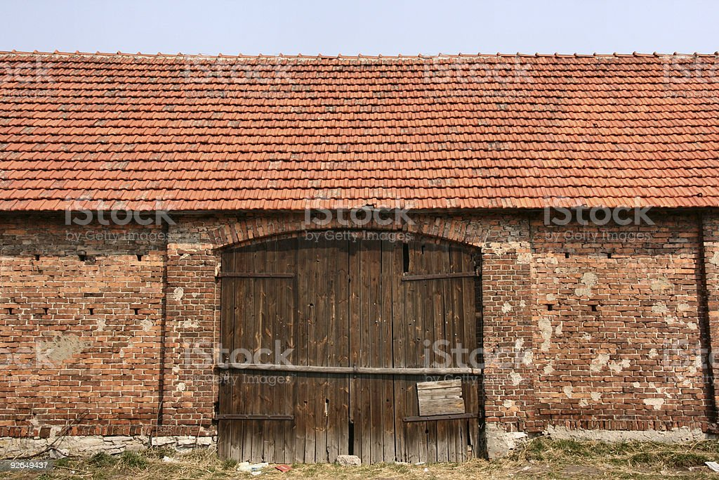 Old brick barn with wooden gate royalty-free stock photo