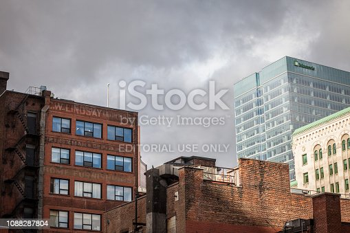 istock Old brick buildings, American architecure, and modern business glass skyscrapers standing in downtown Montreal, the biggest economic hub of Quebec 1088287804