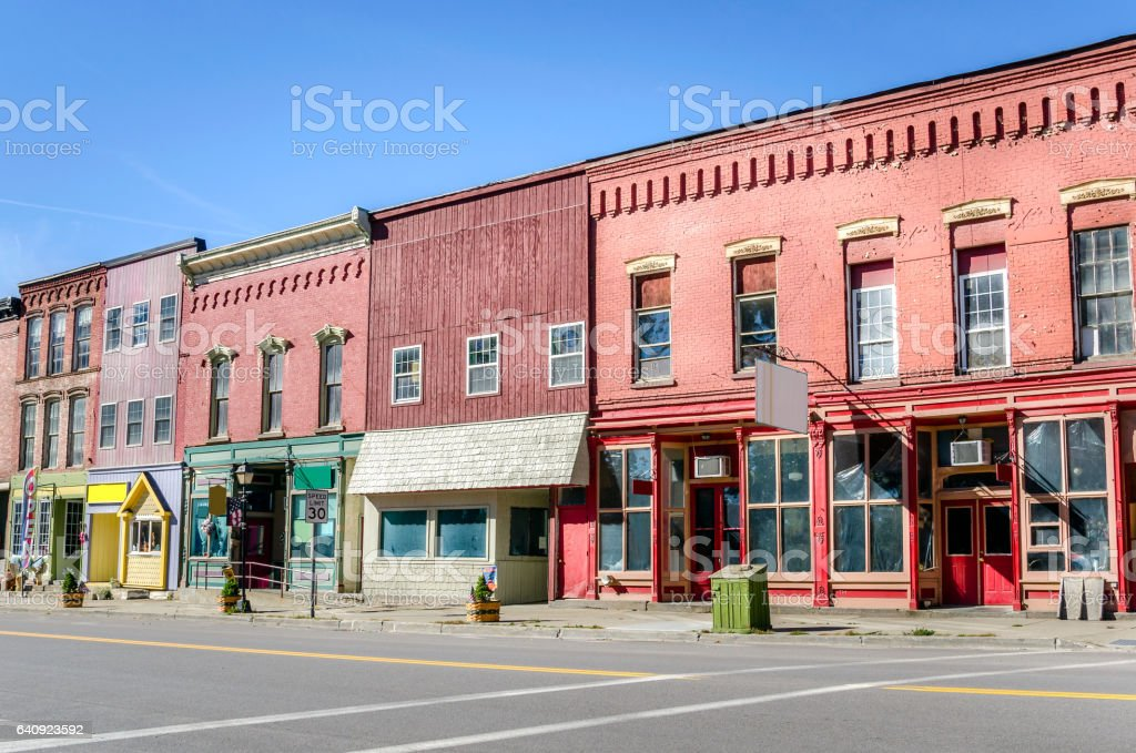 Old Brick Buildings and Colorful Stores stock photo