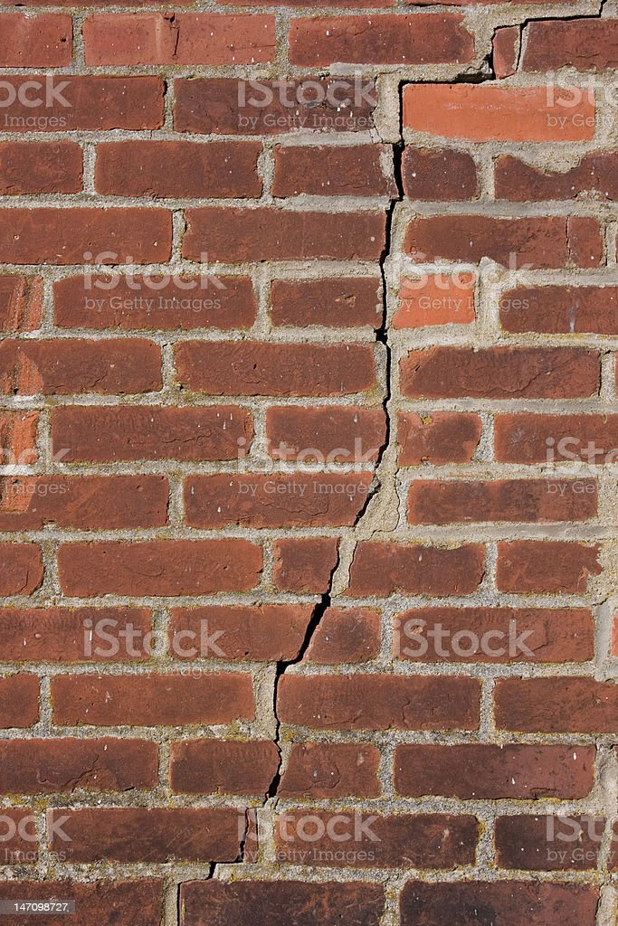 Old Brick House Exterior with a Crack stock photo