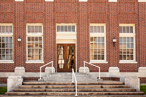 old brick post office building entrance. usa. - school exteriors stock pictures, royalty-free photos & images