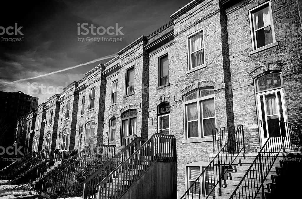 Old Brick Row Houses in Black and White stock photo