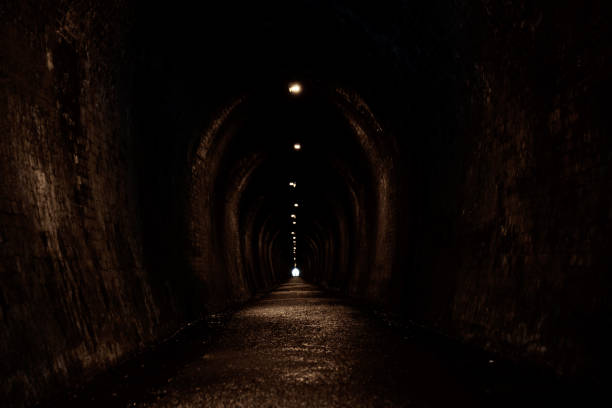 Old brick tunnel. A walkway used to be a railway before. stock photo