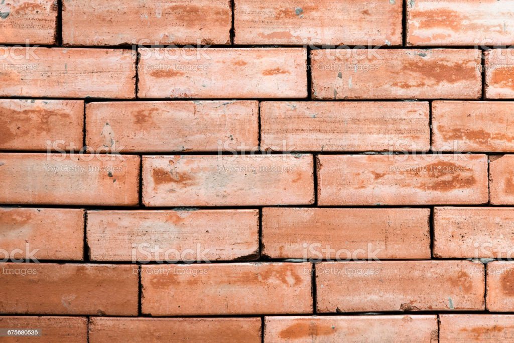 Old brick wall background texture with different style on vintage tone. royalty-free stock photo