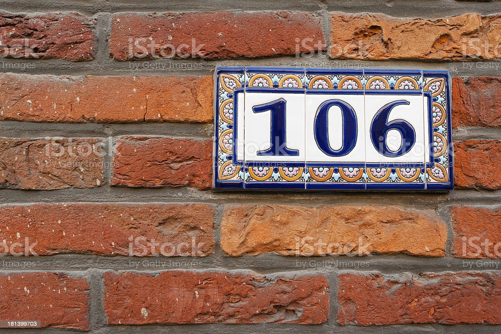 Old brick wall background with numbers royalty-free stock photo